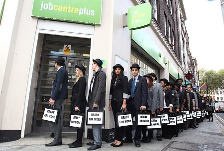 London, Monday 10th October: Unemployed youngsters from across the UK line-up outside of Job Centre, Denmark Street, Central London on Monday 10th October ready to take part in the 'Walk for Work' to Westminster to raise awareness of million young people unemployed, led by Joseph Hayat and Hafsah Ali for their Battlefront campaign